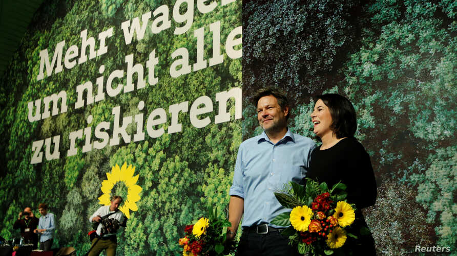 Leaders of Germany's Green Party Robert Habeck (L) and Annalena Baerbock (R) are seen after being re-elected as party leaders…