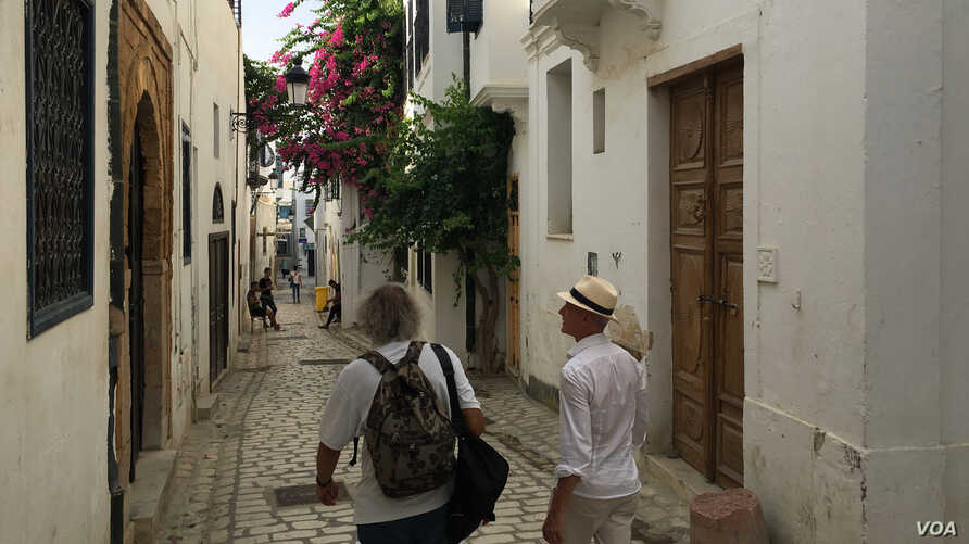 A photo of tourists visiting the Tunis Medina. Ben Gacem suggests Tunisia hasn't sold it's 'best story' to foreigners flocking to the country. (VOA/Lisa Bryant)
