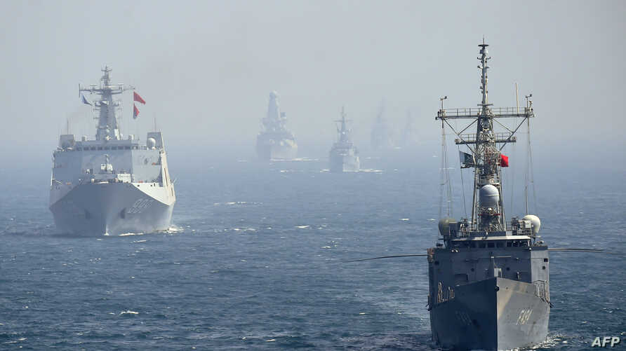 FILE - Chinese and other naval ships are seen in the Arabian Sea near Pakistan's port city of Karachi, Feb. 11, 2019.