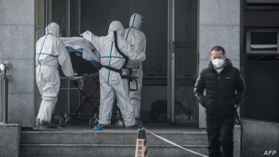 Medical staff transport a patient to Jinyintan Hospital, where patients infected by a mysterious SARS-like virus are being treated, in Wuhan, in China's central Hubei province, Jan. 18, 2020.