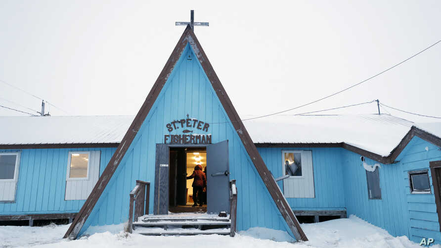 A woman arrives for services at the St. Peter Fisherman Church, Jan. 19, 2020, in Toksook Bay, Alaska. The first Americans to be counted in the 2020 Census starting Jan. 21, 2020, live in this Bering Sea coastal village.