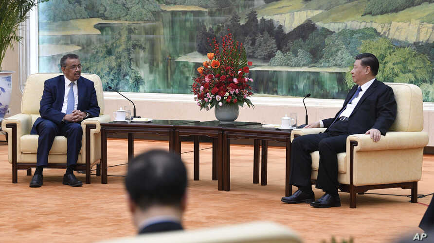 Tedros Adhanom, director general of the World Health Organization, left, meets with Chinese President Xi Jinping at the Great Hall of the People in Beijing, Jan. 28, 2020.