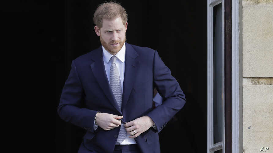 Britain's Prince Harry arrives at the gardens at Buckingham Palace in London, Thursday, Jan. 16, 2020. Prince Harry, the Duke…