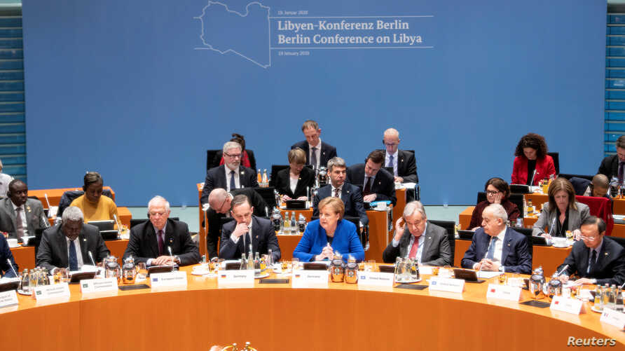 Participants attend the Libya summit in Berlin, Germany, Jan. 19, 2020, hosted by Chancellor Angela Merkel, seated in the center. To her right is United Nations Secretary-General Antonio Guterres.