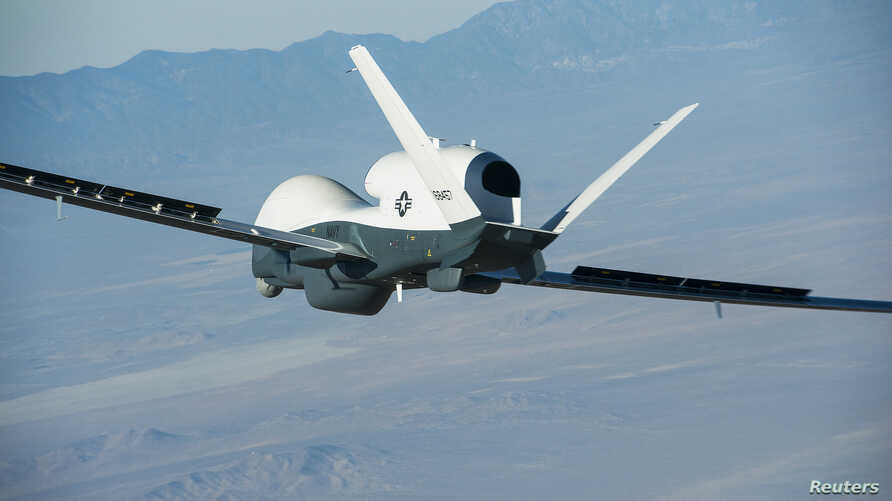 FILE - A U.S. Triton surveillance aircraft is seen during a test flight over Palmdale, California, in this handout photo released by the U.S. Navy May 22, 2013.