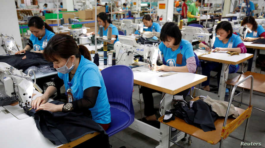 FILE - Women are seen working at Maxport, an export garment factory in Hanoi, Vietnam, March 20, 2019.