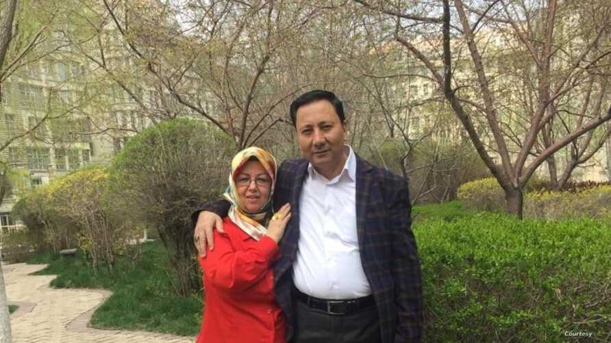 This picture shows Yahya Kurban and Amina Kurban standing in the garden of their apartment complex in Urumqu, the capital city of Xinjiang, China. (Photo courtesy Hankiz Kurban)