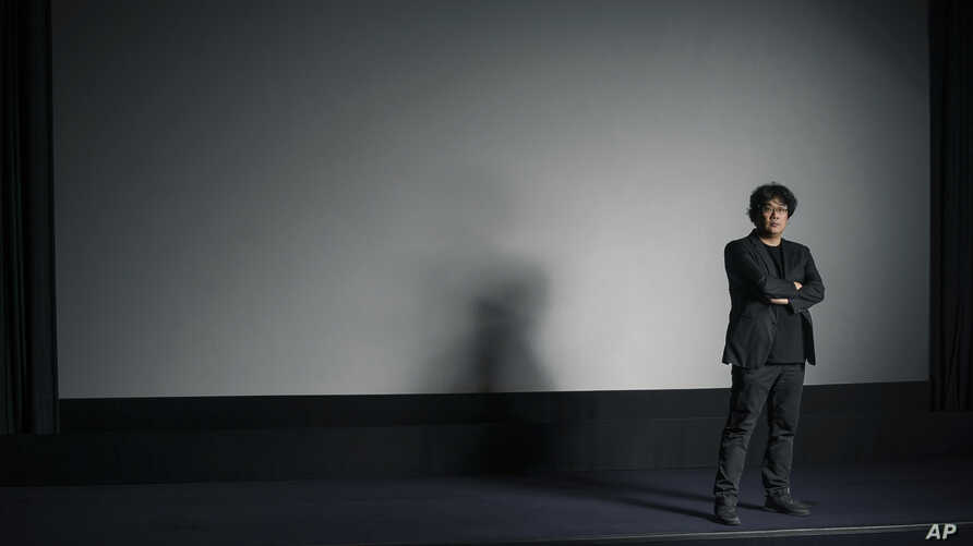 This Oct. 8, 2019 photo shows filmmaker Bong Joon-Ho posing for a portrait at the Whitby Hotel screening room in New York to…