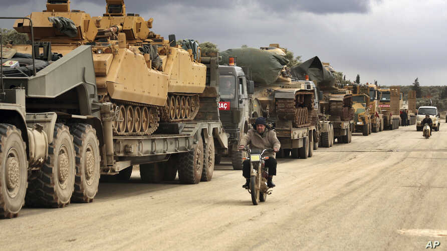 Turkish military convoy drives through the village of Binnish, in Idlib province, Syria, eb. 8, 2020.