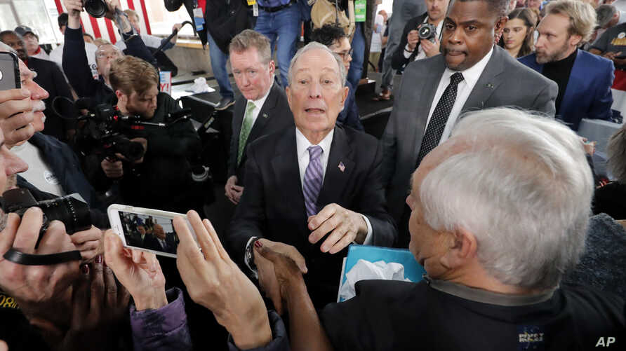 Democratic presidential candidate and former New York City Mayor Mike Bloomberg greets supporters after speaking at a campaign…