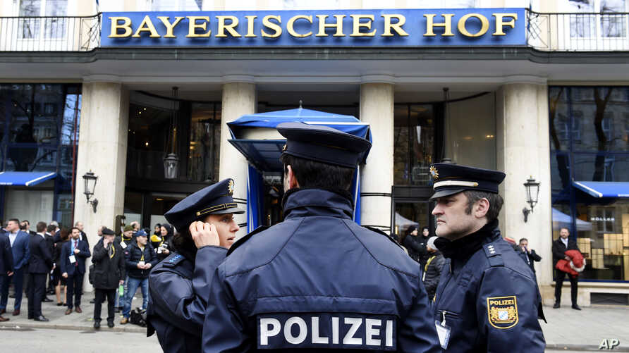 German police officers stand in front of the Bayerischer Hot hotel on the first day of the Munich Security Conference in Munich, Germany, Feb. 14, 2020.