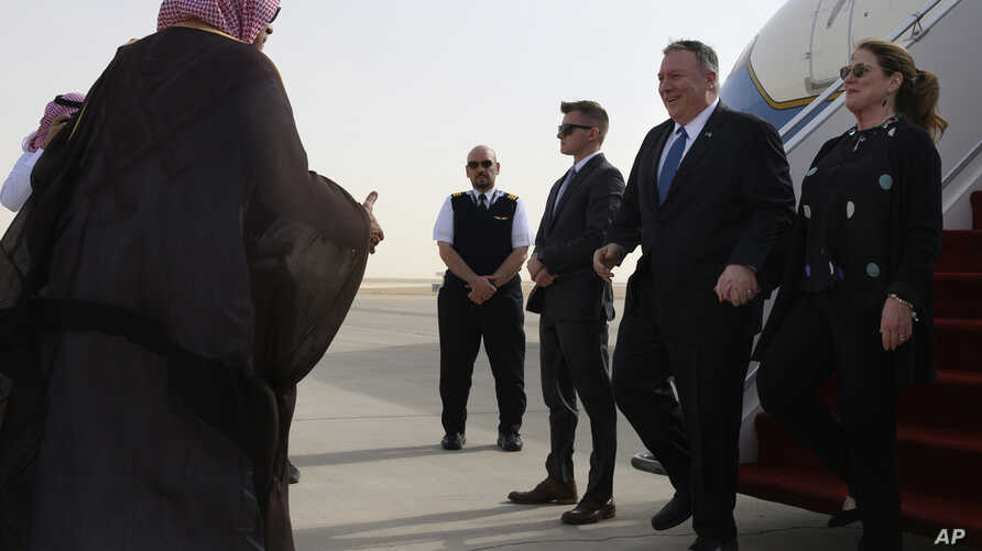 US Secretary of State Mike Pompeo, second right, and his wife Susan are met by a member of Saudi protocol as they arrive at the King Khalid International Airport in the Saudi capital Riyadh, Feb. 19, 2020.