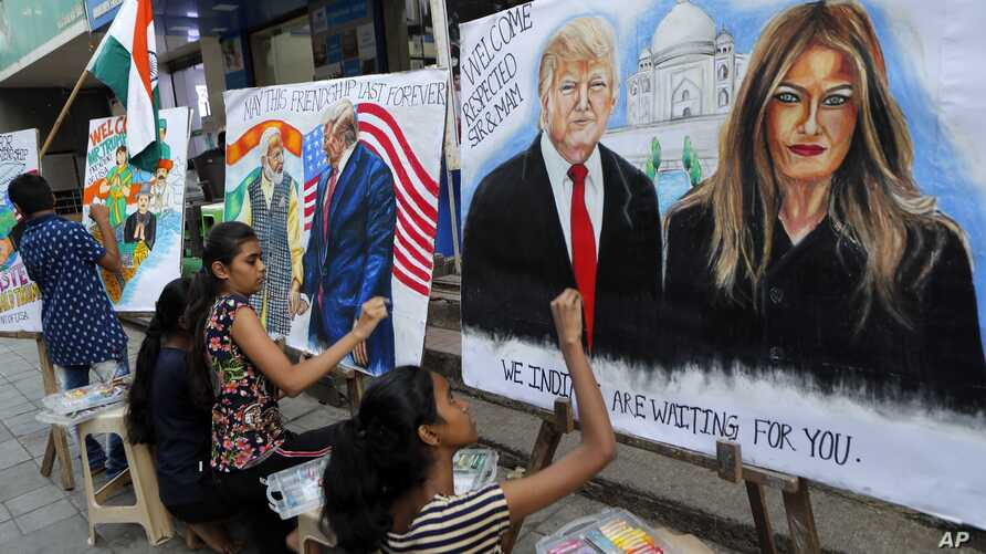 Children from an art school make paintings of U.S. President Donald Trump ahead of his India visit, in Mumbai, India.