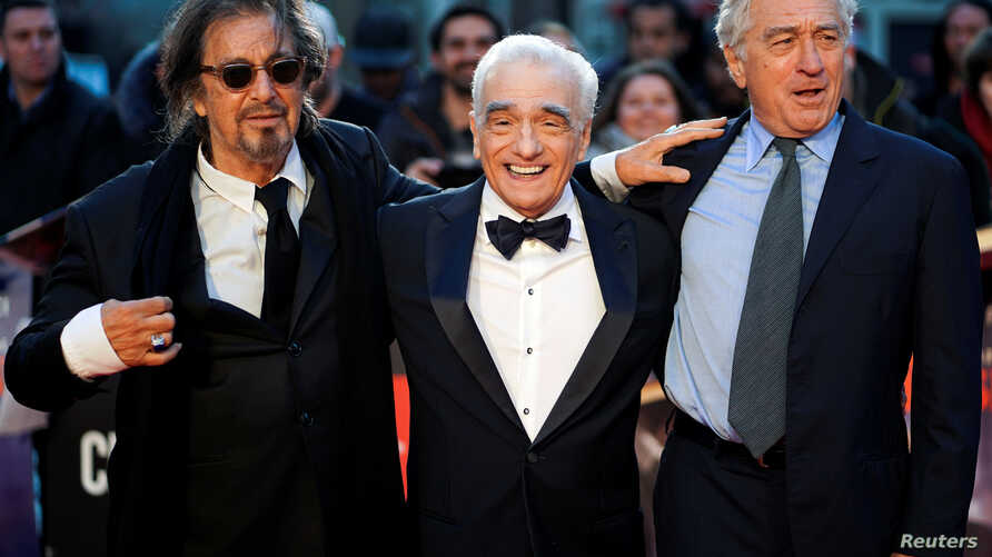 """Director Martin Scorsese and cast members Al Pacino and Robert De Niro pose as they arrive for the screening of """"The Irishman"""" during the 2019 BFI London Film Festival at the Odeon Luxe Leicester Square in London, Britain October 13, 2019."""