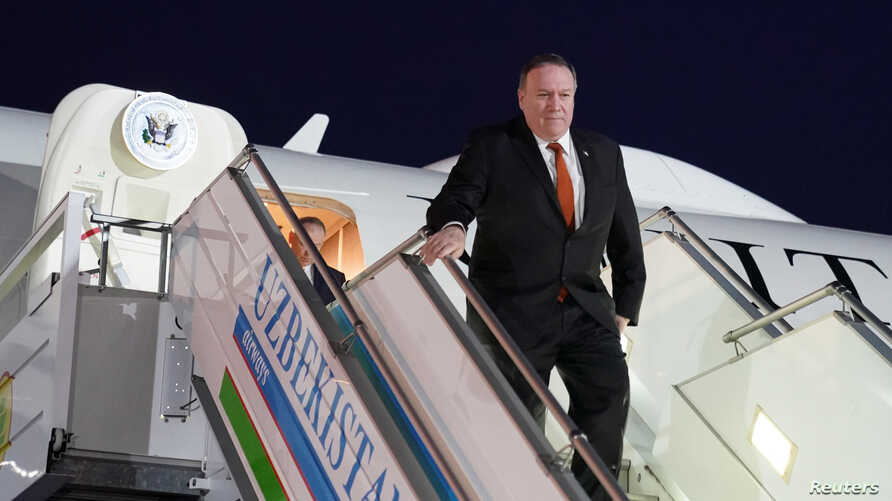 U.S. Secretary of State Mike Pompeo steps from a plane upon arrival in Tashkent, Uzbekistan, February 2, 2020.  REUTERS/Kevin…