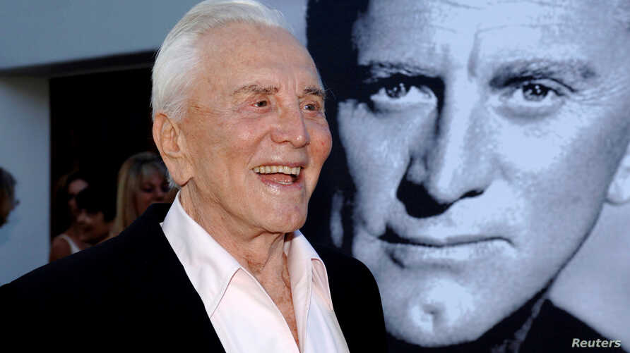 FILE PHOTO: Actor Kirk Douglas arrives to receive an inaugural award for Excellence in film presented by the Santa Barbara…