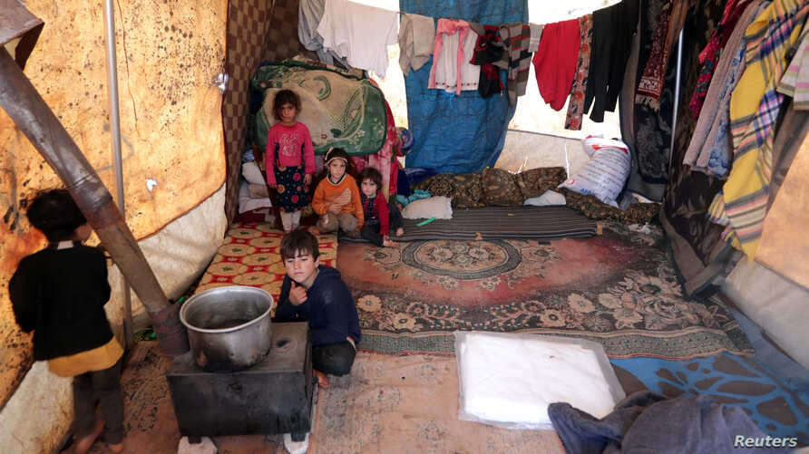 Internally displaced Syrian children from Idlib, are seen inside a tent in Azaz, Syria February 22, 2020. Picture taken…