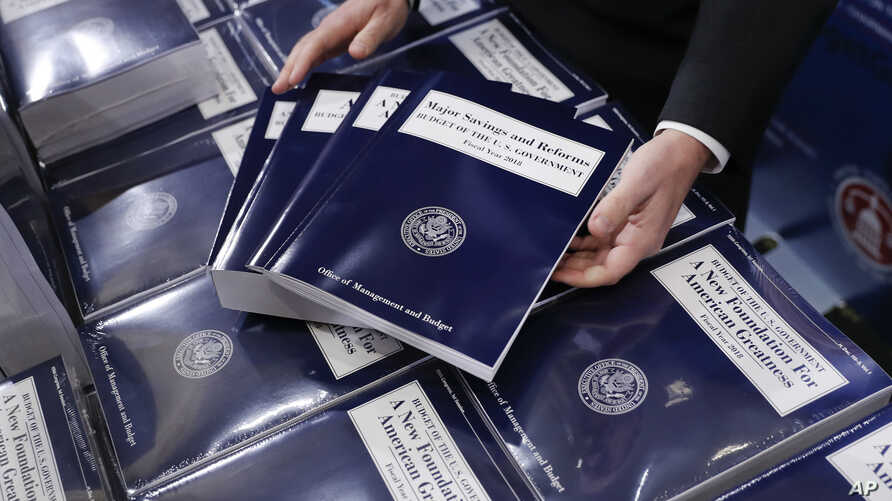 FILE - Copies of President Donald Trump's federal budget are seen on Capitol Hill in Washington, May 23, 2017.