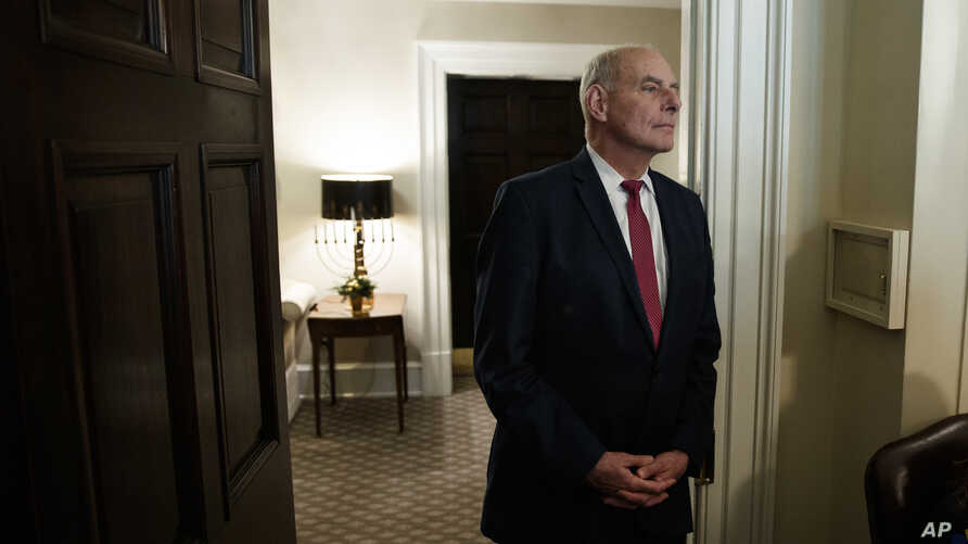 Then-White House Chief of Staff John Kelly listens as President Donald Trump speaks during a meeting in the Cabinet Room of the White House, in Washington, Dec. 13, 2018.