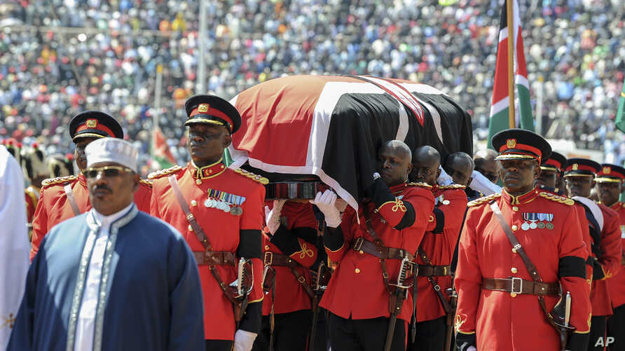 Kenyan military pallbearers carry the casket of former president Daniel arap Moi, draped in a Kenyan flag, at his state funeral in Nyayo Stadium, in Kenya's capital of Nairobi, Kenya, Feb. 11, 2020.