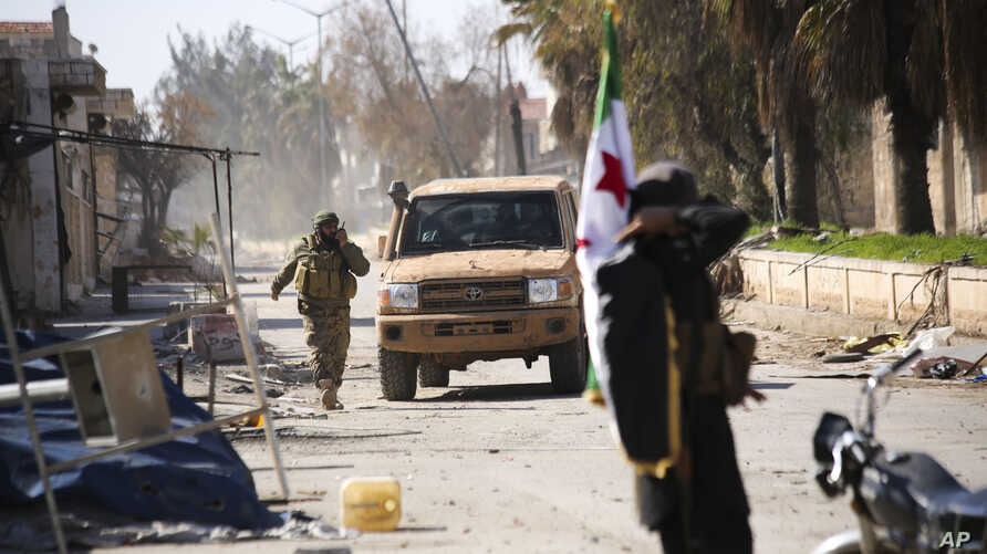 Turkish-backed Syrian rebels enter the town of Saraqeb in Idlib province, Syria, Feb. 27, 2020.