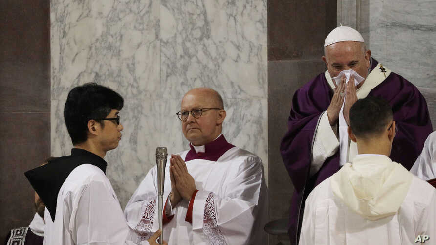 Pope Francis wipes his nose during the Ash Wednesday Mass opening Lent, the forty-day period of abstinence and deprivation for Christians before Holy Week and Easter, inside the Basilica of Santa Sabina in Rome, Italy, Feb. 26, 2020.