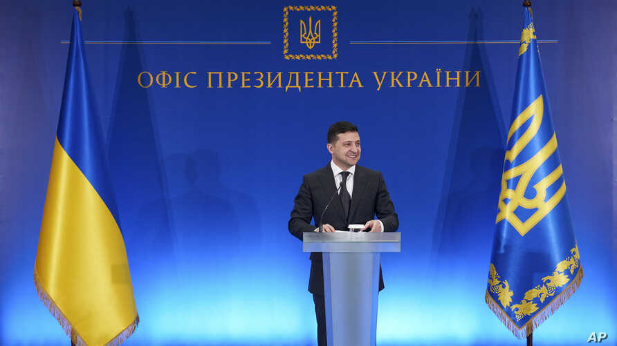 FILE - In this handout photo released by the Ukrainian Presidential Press Office, Ukrainian President Volodymyr Zelenskiy speaks at a ceremony in Kyiv,  Ukraine, Feb. 13, 2020.
