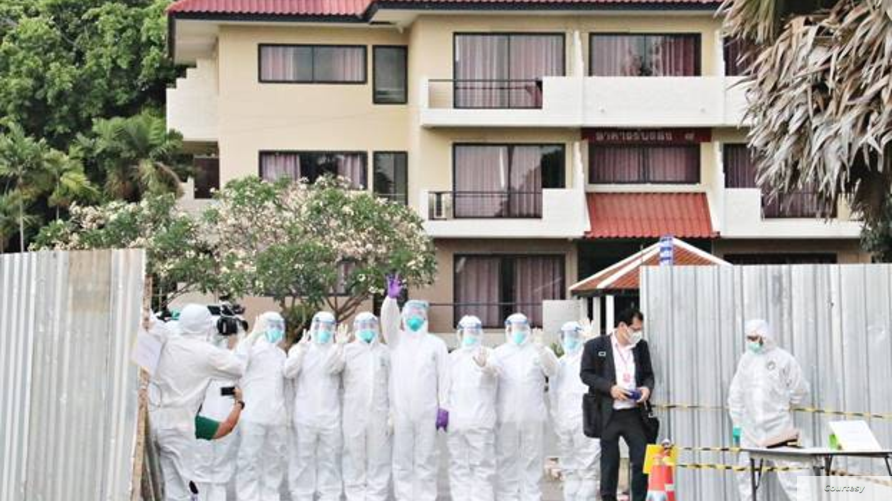 Source: The Royal Thai Naval Base     Caption: Thai medical staff stand in front of a facility at the Satthahip Naval Base where Thai citizens who were evacuated from China's city of Wuhan, are quarantined for 14 days, after their arrival on February 4, 2020.