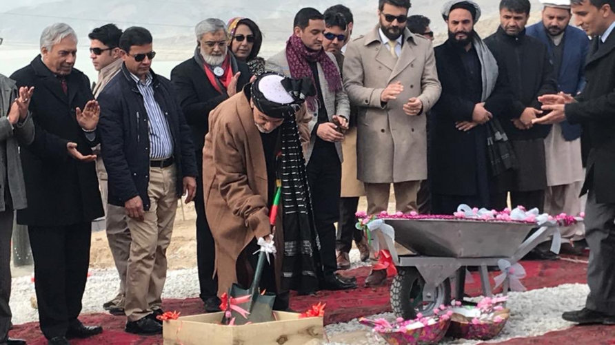 Afghan President Ashraf Ghani is seen laying the foundation stone for the future CASA-1000 transmission line at the groundbreaking site, east of the capital, Kabul, in a photo published Feb. 6, 2020, on his Twitter feed.