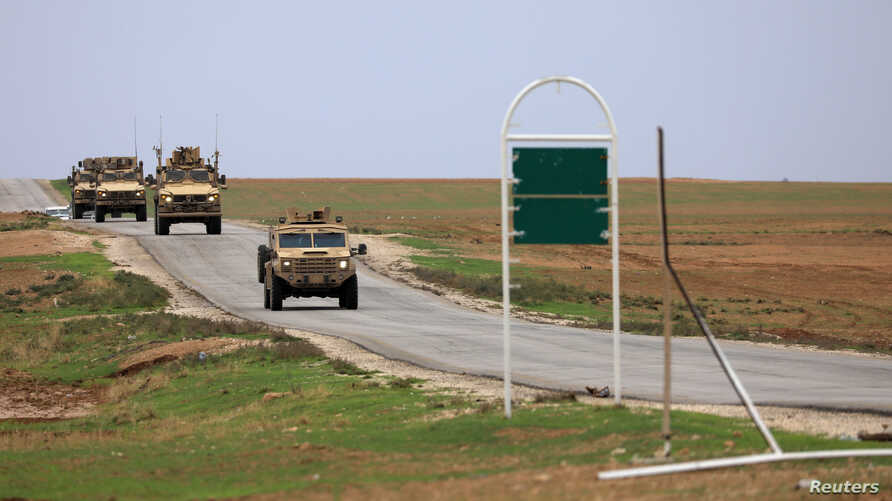 FILE - U.S. military vehicles are seen in Hasakah, Syria, Nov. 4, 2018.