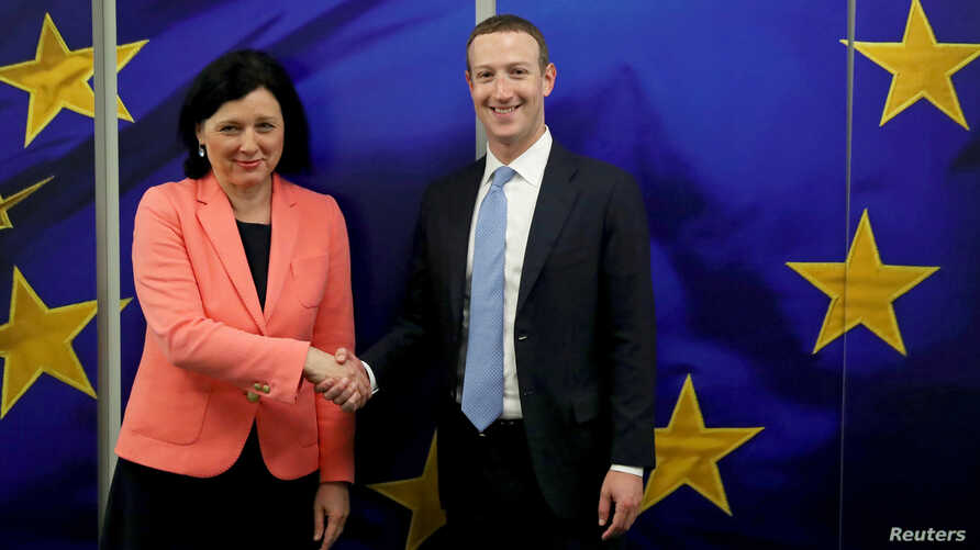 Facebook Chairman and CEO Mark Zuckerberg meets with European Commissioner for Values and Transparency Vera Jourova at the EU Commission headquarters in Brussels, Belgium, Feb. 17, 2020.