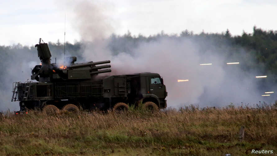 "FILE - A Russian Pantsir-S1 missile and artillery weapon system fires during a demonstration at the international military-technical forum ""ARMY-2016"" in Moscow region, Russia, Sept. 6, 2016."