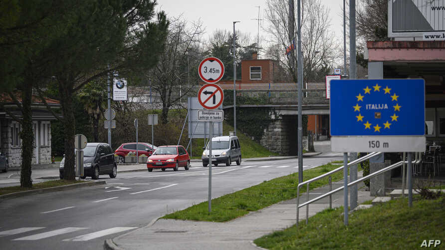A picture shows cars exiting and entering Slovenia at one of the former border crossings in Nova Gorica, on the Slovenian…