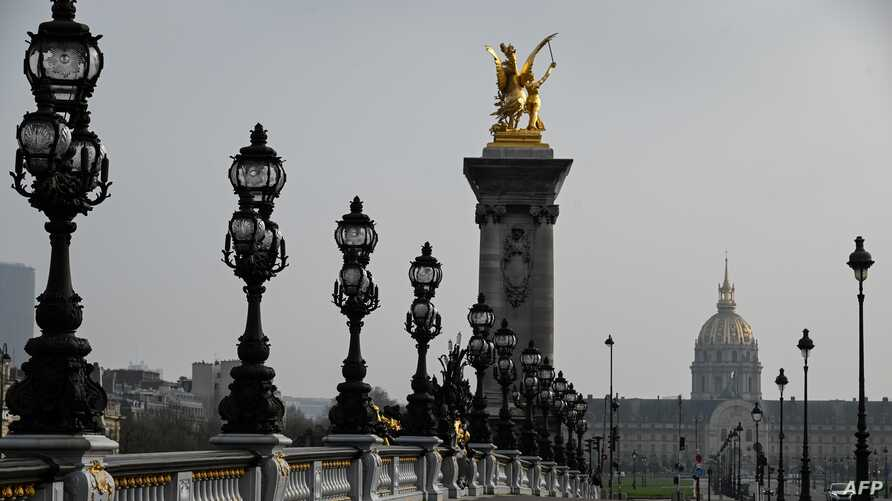 A picture taken on March 20, 2020 in Paris, shows a deserted bridge Pont Alexandre III, on the fourth day of a strict lockdown…