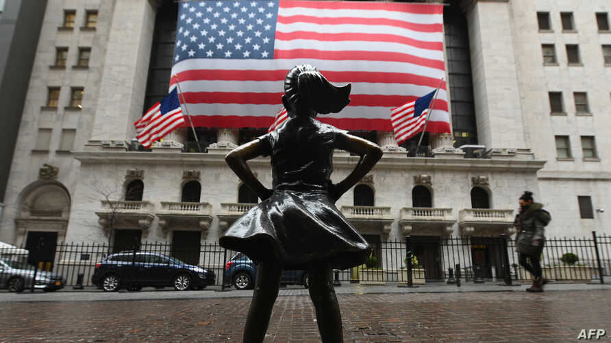 The Fearless Girl statue stands in front of the New York Stock Exchange near Wall Street on March 23, 2020 in New York City. -…
