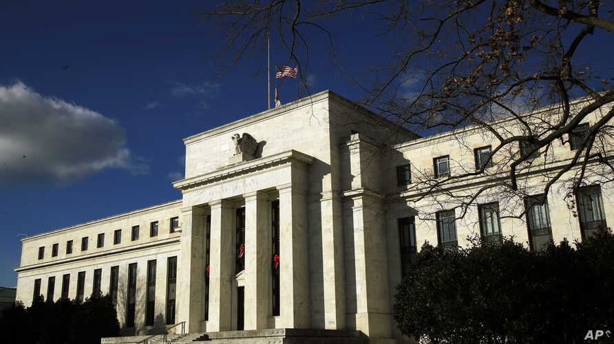The Federal Reserve building is seen during a partial government shutdown in Washington, Monday, Dec. 24, 2018. President…