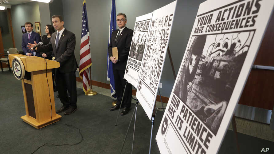 Raymond Duda, FBI Special Agent in Charge in Seattle, speaks during a news conference at a podium at left, Wednesday, Feb. 26,…