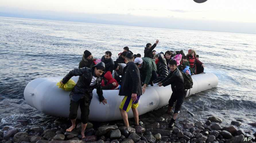 Migrants arrive at the village of Skala Sikaminias, on the Greek island of Lesbos, after crossing on a dinghy the Aegean sea…