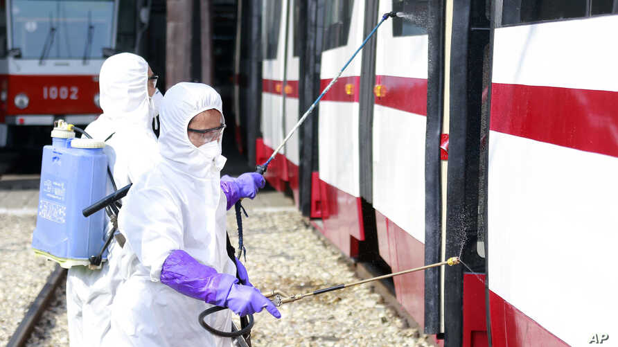 Members from an emergency anti-epidemic headquarters in Mangyongdae District, disinfect a tramcar of Songsan Tram Station to prevent new coronavirus infection in Pyongyang, North Korea, Feb. 26, 2020.