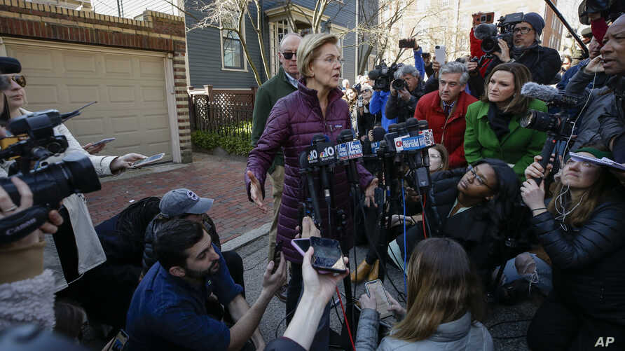 Sen. Elizabeth Warren, D-Mass., speaks to the media outside her home, Thursday, March 5, 2020, in Cambridge, Mass., after she…