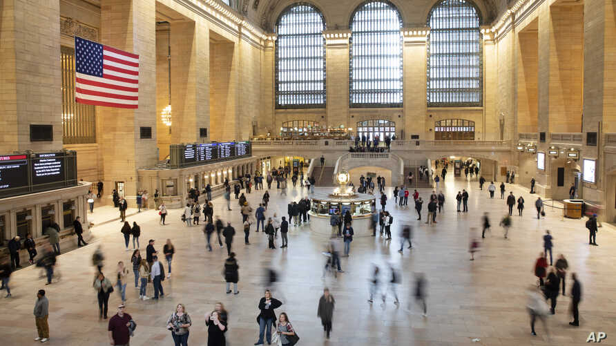 Commuters pass through Grand Central Terminal, Tuesday, March 10, 2020 in New York. Some people are restricting how much they travel due to the concern for COVID-19.