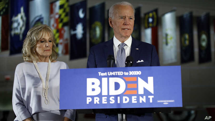 Democratic presidential candidate former Vice President Joe Biden, accompanied by his wife Jill, speaks to members of the press.