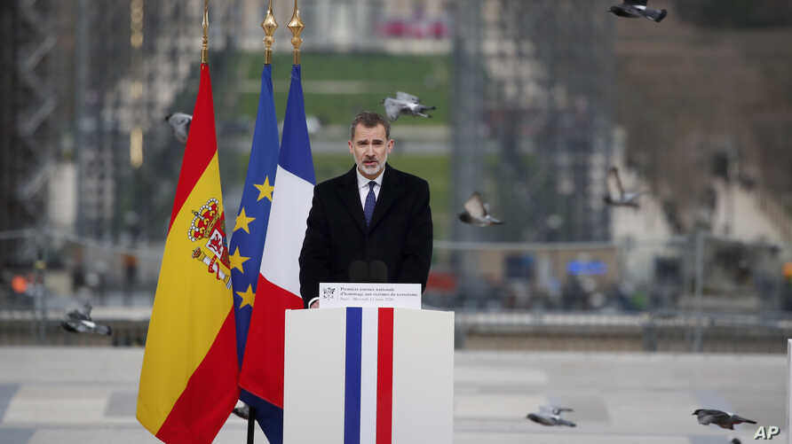 Spain's King Felipe VI delivers his speech during a ceremony to honor victims of terror attacks in Europe, on the 16th anniversary of Madrid attacks, at the Trocadero in Paris, Wednesday March 11, 2020.