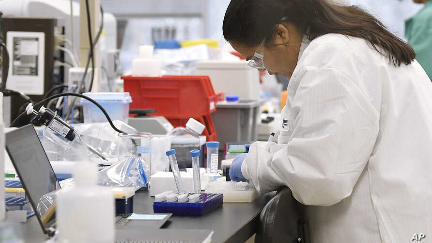 A researcher at Protein Sciences works in a lab, Thursday, March 12, 2020, in Meriden, Conn.