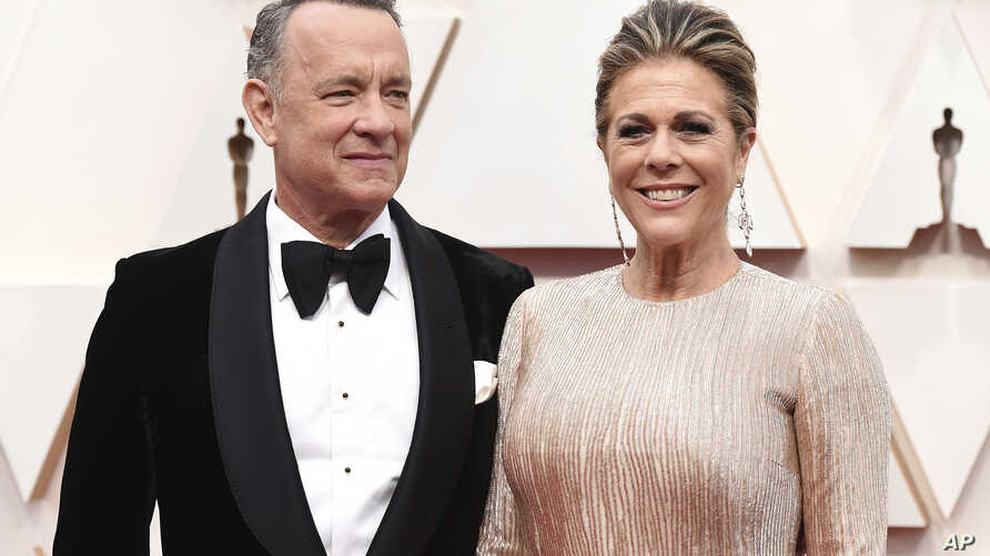 FILE - In this Sunday, Feb. 9, 2020 file photo, Tom Hanks, left, and Rita Wilson arrive at the Oscars