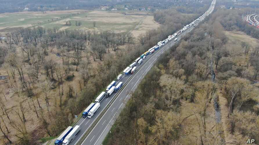 Trucks are stuck in traffic jams on the A12 autobahn in the direction of Poland near near Frankfurt (Oder), Germany, Tuesday, March 17, 2020.