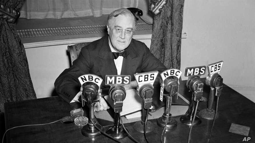 FILE - President Franklin D. Roosevelt speaks on the radio from the Oval Room of the White House. During an extraordinary 12 years in office, Roosevelt guided the nation through a bleak period of Depression-era unemployment, Feb. 27, 1941.