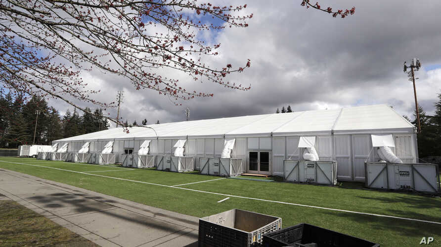 One of a pair of massive temporary buildings meant for use as a field hospital for coronavirus patients stands on a soccer field in the Seattle suburb of Shoreline, Washington, March 24, 2020.