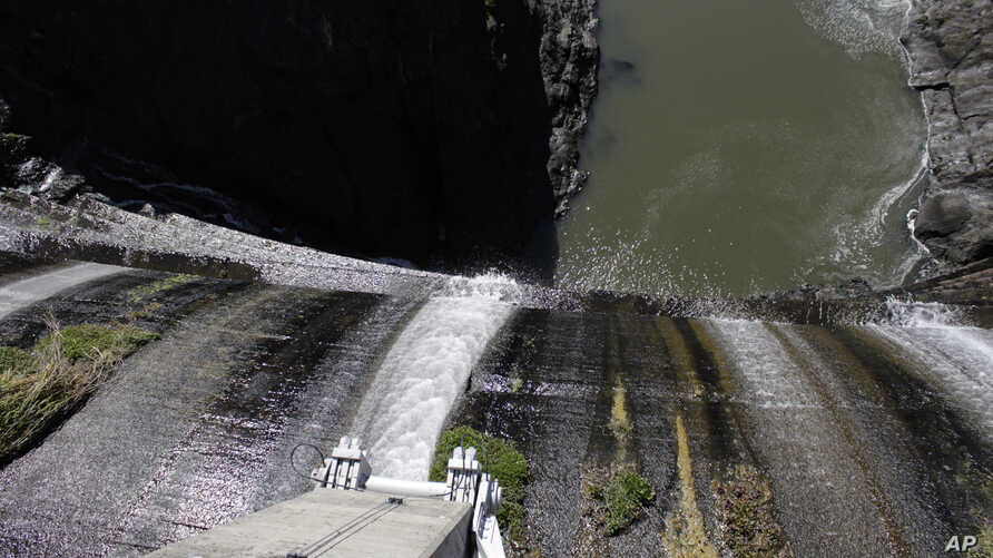Excess water spills over the top of a dam on the lower Klamath River known as Copco 1 near Hornbrook, California, March 3, 2020.
