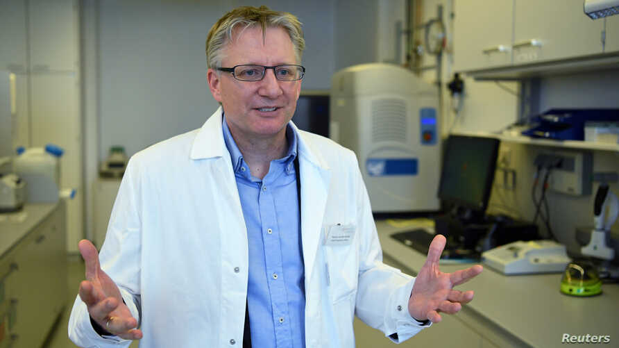 Florian von der Muelbe, COO of German biopharmaceutical company CureVac, explains the company's research on a vaccine for the coronavirus (COVID-19) disease at a laboratory in Tuebingen, Germany, March 12, 2020.